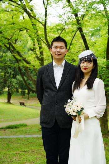 Bride And Groom Wedding Dress Two People Adult Plant Tree Young Adult Couple - Relationship Emotion Togetherness Standing Portrait Love Looking At Camera Green Color