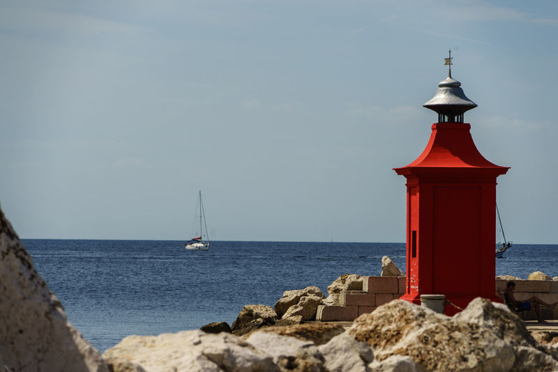 Architecture Beach Beauty In Nature Building Exterior Built Structure Day Horizon Over Water Lighthouse Nature No People Outdoors Red Rock - Object Scenics Sea Sky Tranquil Scene Tranquility Water