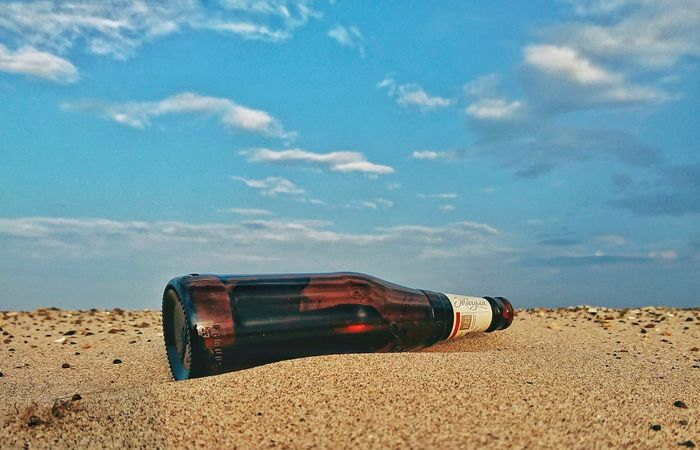 Civilization comes Sonyxperia Nature Naturelovers Nature_collection Nature Photography Bottle Collection Bottle Sand Blue Sky Blueskies Blueandyellow Civilization Civilization Meets Nature