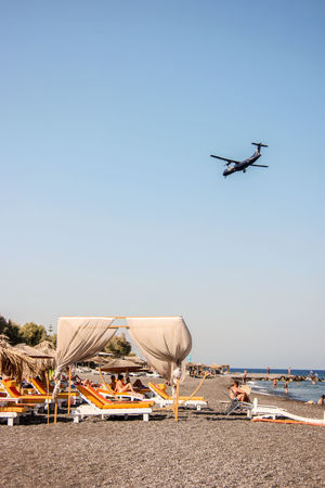EyeEm Selects Flying Beach Air Vehicle Helicopter Sky Sand Outdoors Clear Sky Industry Day Water No People Oil Pump Vacations Fira Santorini Santorini Horizon Over Water Clear Sky Airplane Connected By Travel EyeEmNewHere