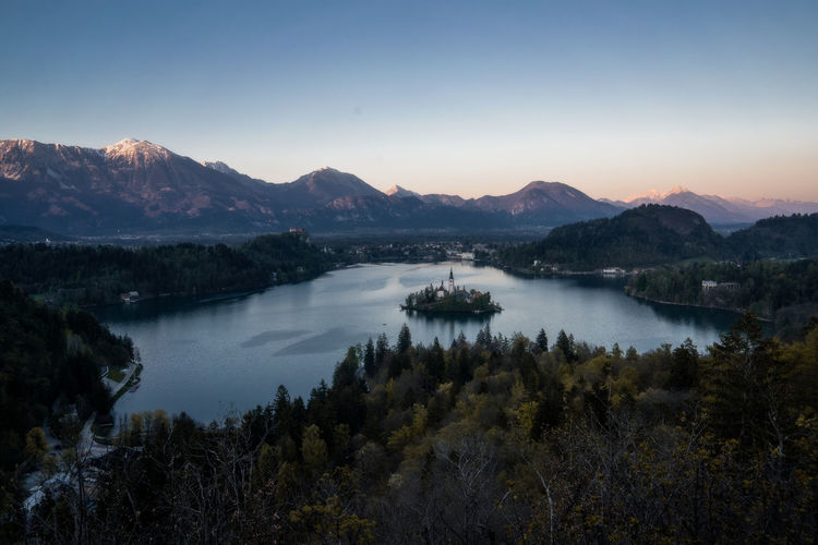 Sunset in Bled, Slovenia Mountain Scenics - Nature Sky Beauty In Nature Tranquil Scene Tranquility Water Mountain Range Lake Plant Nature No People Environment Non-urban Scene Tree Idyllic Landscape Clear Sky Outdoors