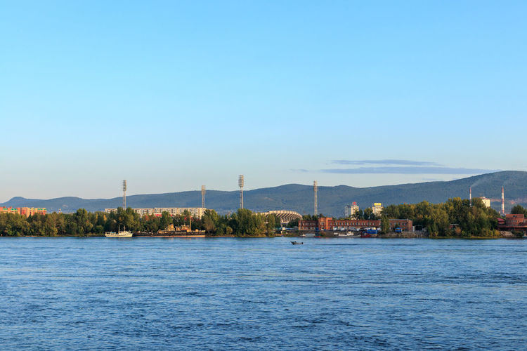 Krasnoyarsk Riverside Siberian Husky Yenisei River Blue Built Structure Day No People Outdoors River Riverbank Sky Tranquil Scene Tranquility View Into Land Water Waterfront