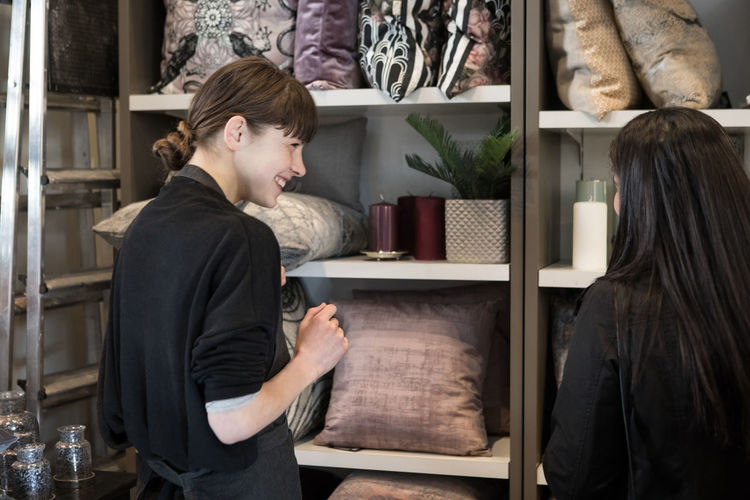 Side view of couple standing in store