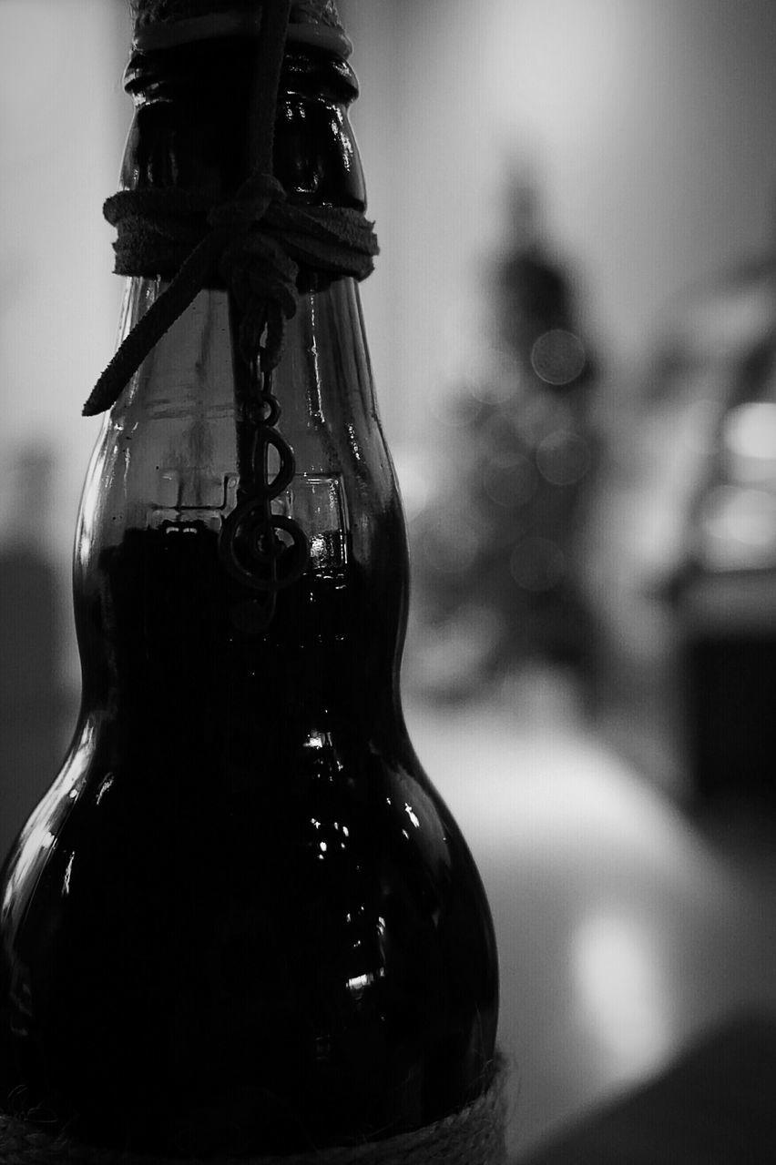 Detail Shot Of A Bottle Against Blurred Background
