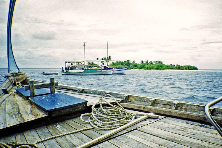 Dhonis at the Maldives Indian Ocean Maldives Tropics ASIA Boats Coast Dhoni Dhonis Fishing Boat Island Isle Marine Mode Of Transportation Moored Nautical Vessel Outdoors Rope Sailboat Sea Ship Tranquility Transportation Travel Water Yacht