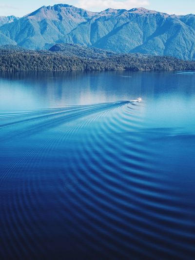 Ripples Boat Water Scenics - Nature Blue Beauty In Nature Sea Tranquility Nature Tranquil Scene Mountain Landscape Idyllic Travel Destinations Environment Water Scenics - Nature Blue Beauty In Nature Sea Tranquility Nature Tranquil Scene Mountain Landscape Idyllic Travel Destinations Environment