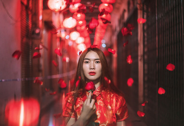 Happiness Blooms From Within. 🐲🏮 Chinese New Year. Red Young Adult One Person Portrait Young Women Beauty Front View Hair Long Hair Night Beautiful Woman Looking Away Women Looking Illuminated Chinese New Year Rosé Rose - Flower Lifestyles Celebration Light Light And Shadow Lights Lighting Equipment Lighthouse