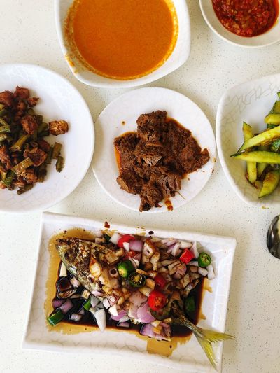 Indonesian lunch in Singapore Fish Indonesian Food Curry Beef Rendang Singapore Malaysian Food Food Food And Drink Healthy Eating Plate Indoors  Ready-to-eat High Angle View No People Close-up Serving Size Vegetable