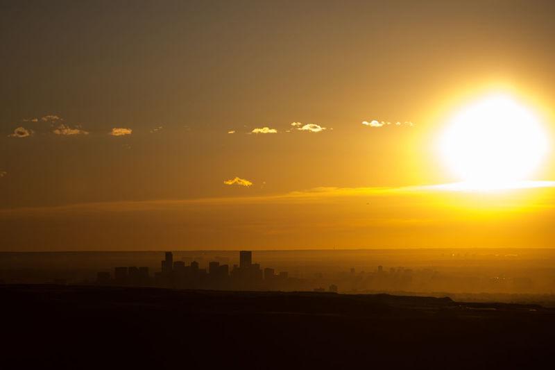 A Denver, sunrise silhouette. Sky Sun Sunset Beauty In Nature Nature Sunlight Silhouette Scenics - Nature Tranquil Scene Tranquility Orange Color Lens Flare Horizon Environment No People Water Idyllic Outdoors Landscape Sunbeam Bright Design Colorado Sunrise City