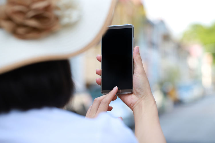 Rear View Of Woman Using Phone