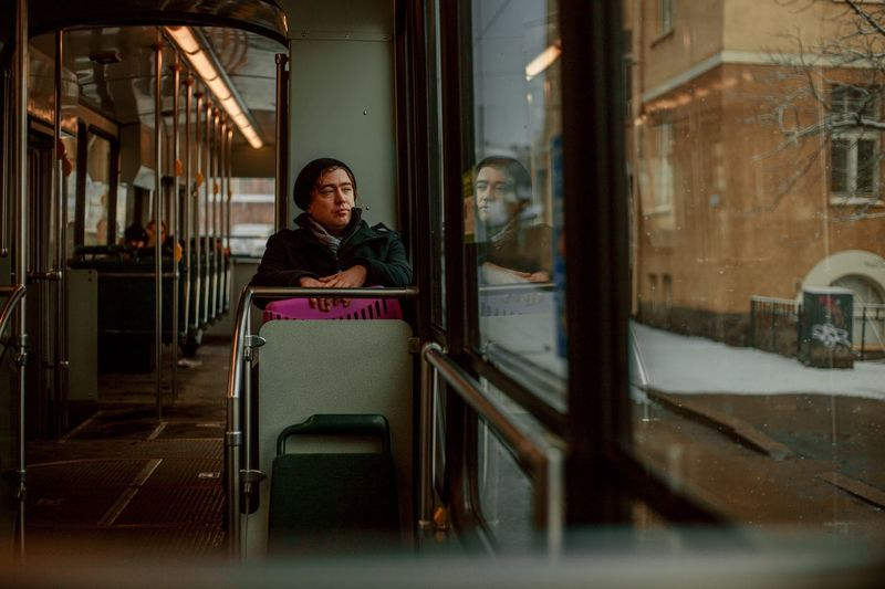 human in transit Street Photography People In Motion Real People Women Of EyeEm Bus Transit One Person Sitting Young Adult Adult Architecture Portrait Real People Women Females Looking Young Women Contemplation Window International Women's Day 2019