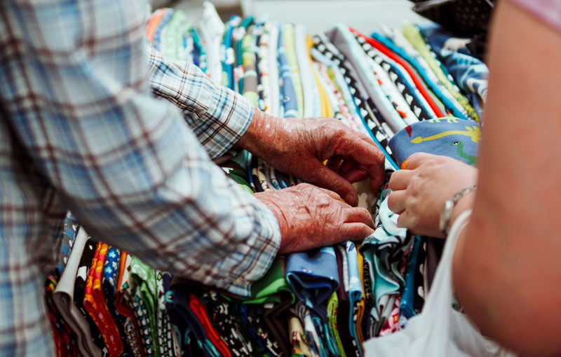 Close-up of people browsing fabrics