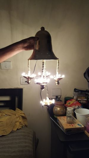 View of electric lamp hanging on table at home