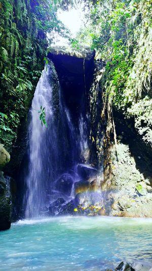 one trip holiday EyeEm EyeEmNewHere EyeEm Nature Lover EyeEm Indonesia Water Waterfall Power In Nature Tree Motion Waterfront Calm Flowing Water Mid Distance Rock Formation Rock