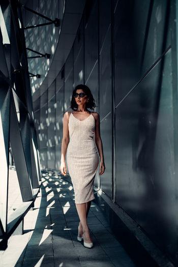 Full length of woman standing against bridge