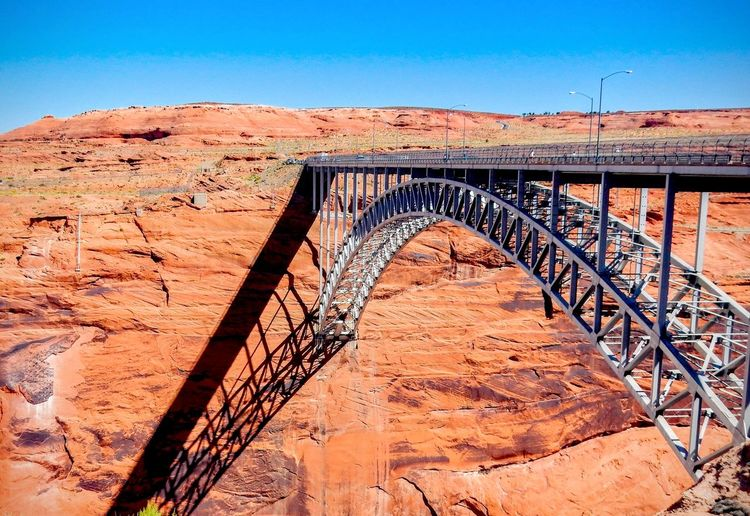 Bridge against rocky mountains