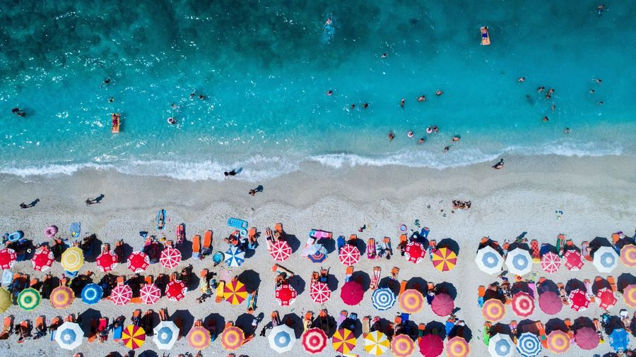 Summer Colors Crowd Large Group Of People Group Of People Sport Water Multi Colored Real People Sea Leisure Activity Beach Lifestyles Competition Nature Aquatic Sport Outdoors High Angle View Land Day