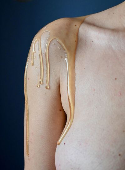 Close-up of woman covered in honey
