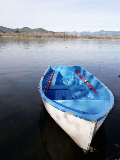 Estany De Banyoles Banyoles Girona Catalunya Catalonia Water Nautical Vessel Moored Blue Rowboat Reflection Sky