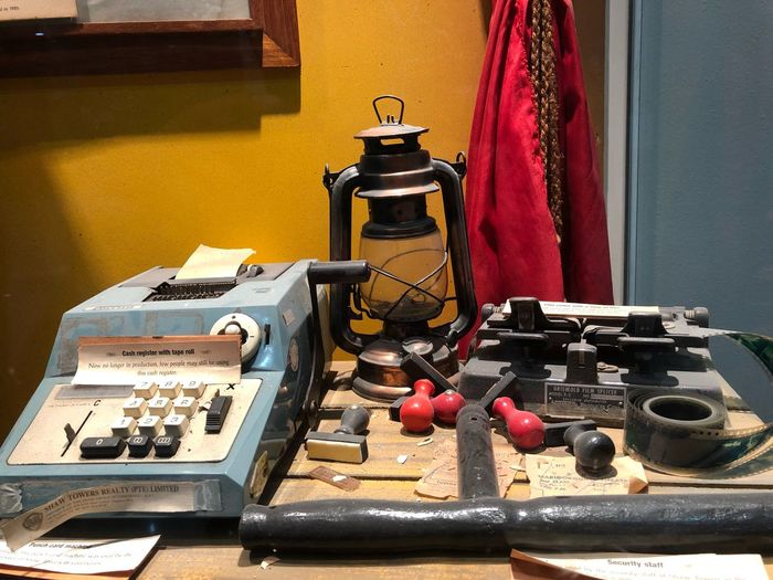 Close-up of old-fashioned technologies on table