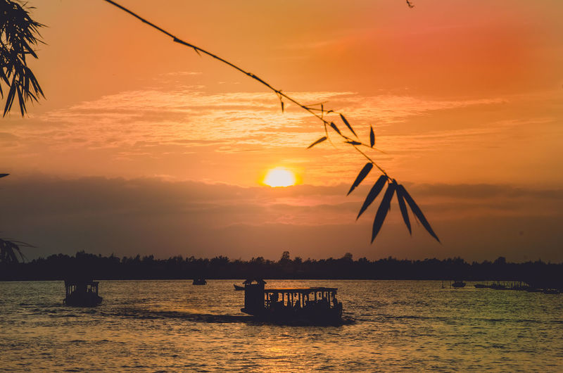 Beauty In Nature Cloud - Sky Idyllic Nature No People Orange Color Outdoors Scenics - Nature Sea Silhouette Sky Sun Sunset Tranquil Scene Tranquility Transportation Turbine Water Waterfront