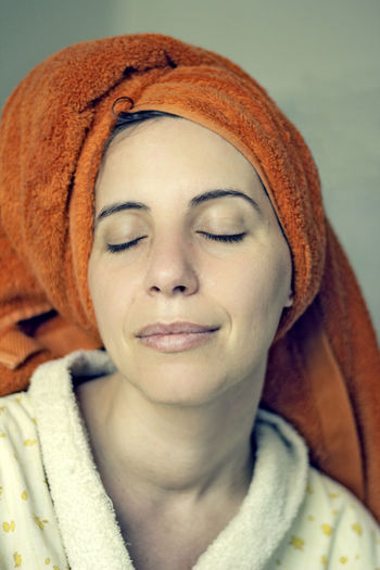 Adult Beautiful Woman Beauty Beauty Spa Close-up Day Eyes Closed  Front View Headband Headshot Indoors  Lifestyles One Person Portrait Real People Towel Turban Warm Clothing Wrapped Young Adult Young Women
