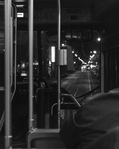 Train at illuminated railroad station at night