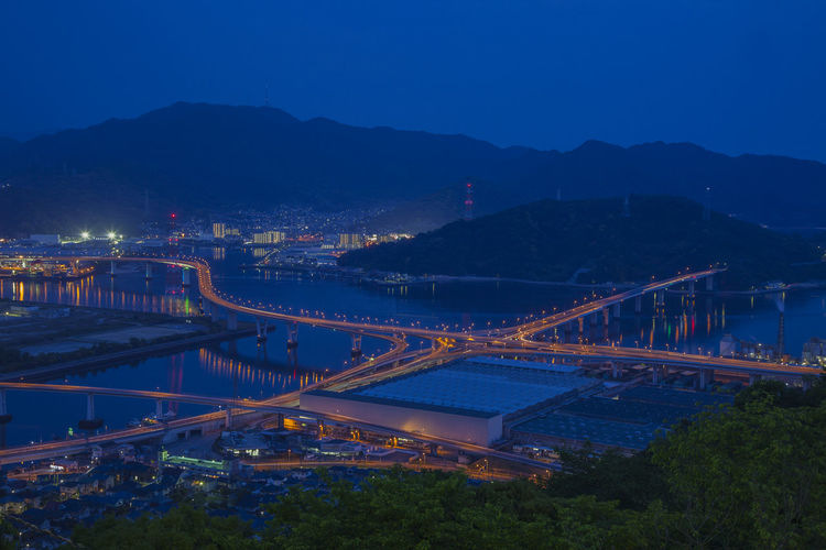 High Angle View Of Illuminated Hiroshima-Shi Bridge Over City Against Sky