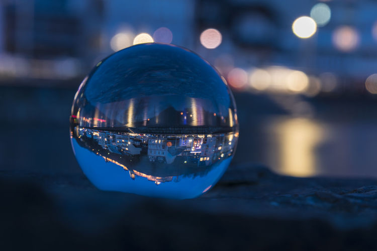 Close-up of crystal ball in water at night