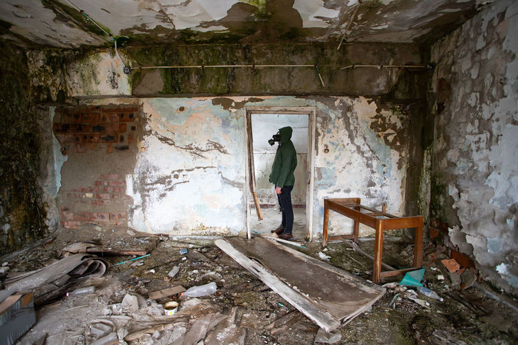 Man standing in abandoned building