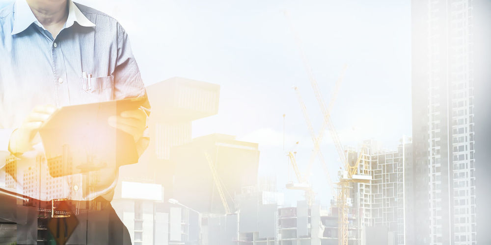 Standing One Person Business City Adult Architecture Building Exterior Holding Sunlight Men Occupation Business Person Lens Flare Built Structure Young Adult Working Day Nature Outdoors Office Building Exterior Cityscape Skyscraper Digital Composite