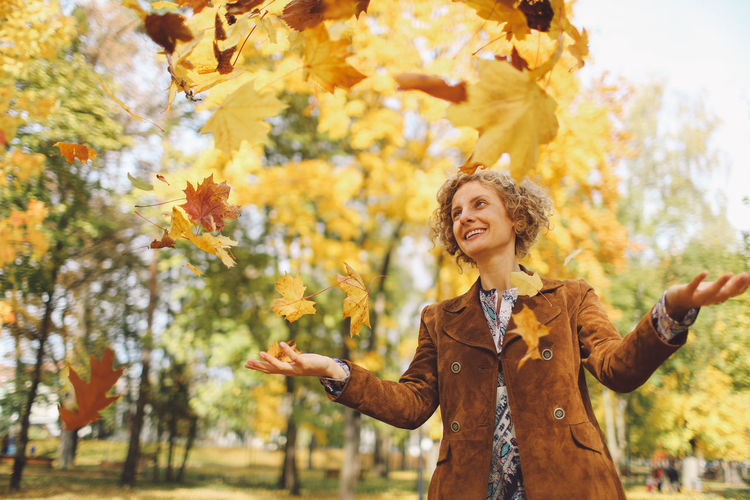 Adult Autumn Autumn Autumn Colors Autumn Leaves Beauty In Nature Cheerful Colors Curly Hair Females Girl Happiness Leafs Nature One Person One Woman Only One Young Woman Only Only Women Outdoors Park People Smiling Standing Tree Trees Paint The Town Yellow