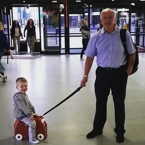 A boy and his grandad. Cute Child Toddler  Smiles Trunkie Airport Grandad