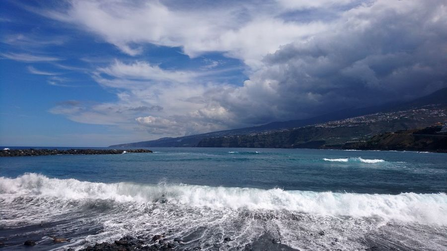 Tenerife waves. Tenerife Canary Islands Islas Canarias SPAIN España Blue Ocean Atlantic Atlantic Ocean Waves Wake Wake - Water Clouds Clouds And Sky Cloudscape Beauty In Nature Beauty Whitewater Water Sea Beach Mountain Blue Sky Landscape Horizon Over Water Cloud - Sky