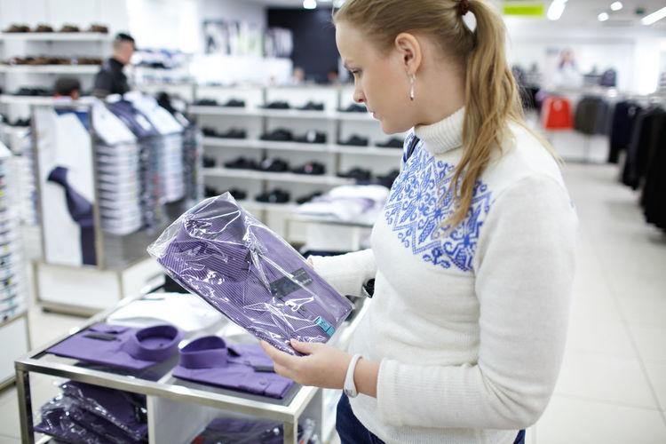 Woman buying shirt in store