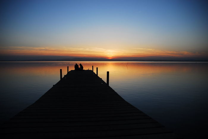 Sunset Silhouette Water Sky Tranquility Beauty In Nature Horizon Over Water Nature Summer Horizon Day Orange Color Relaxation Cloud - Sky Floating On Water EyeEm Nature Lover Aquatic Beauty Landscape Lake Symmetry Clear Sky Silence Idyllic