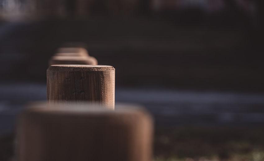 Close-up of wooden bollard outdoors
