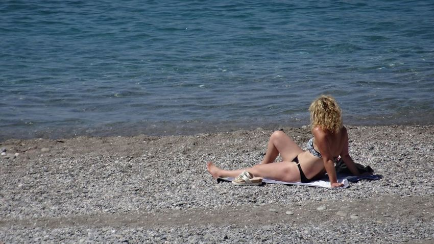 Thoughts sliding on the water Beach Relaxation Seaside Sicily Solitude Sunbathing Thinking About Life Tourist Tranquility Vacations Backside Portrait Young Woman Bikini Girl On The Shore