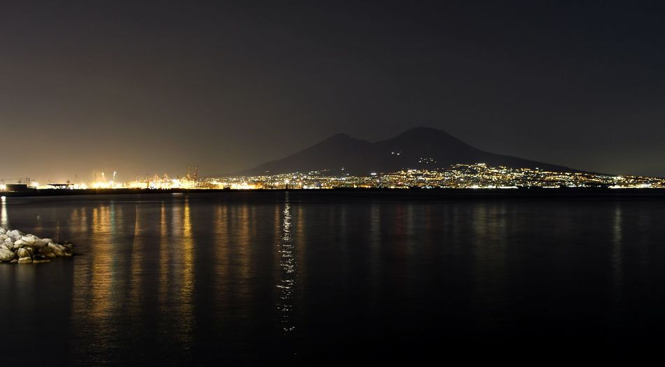 Illuminated Water Reflection Sky Night Built Structure Waterfront No People Architecture Outdoors Mountain Clear Sky Sea Nature Napoli City