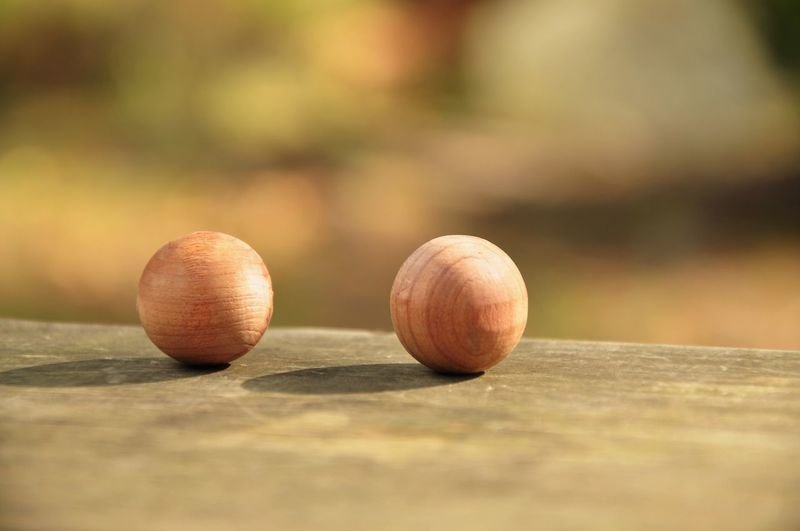 Close-Up Of Wooden Balls On Table