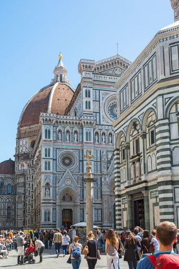 People walking on the piazza del duomo at cattedrale di santa maria del fiore in florence