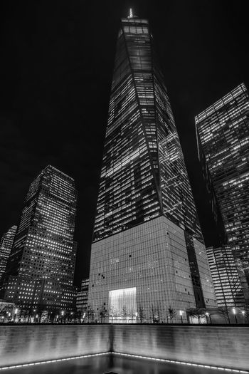 Low angle view of illuminated one world trade center against sky at night