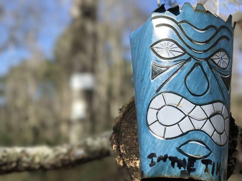 Tiki Mask Portrait Blue Close-up Day Focus On Foreground No People Outdoors Sky Tiki Trash Art Tree