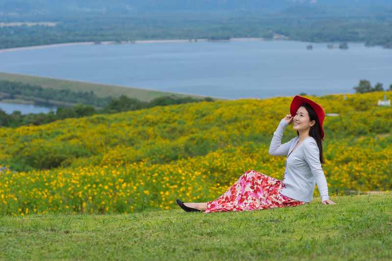 Beautiful woman in nature flower, Her wear white dresses and red hat in Tung Bua Tong Mexican sunflower field in Mae Moh Coal Mine, Lampang Province, Thailand. Advertising Asian  Background Beautiful Beauty Bua Caucasian Cheerful Coal Dress Enjoy Female Field Flower Freedom Girl Green Hair Happiness Happy Lady Lampang Lifestyle Mãe Mexican Mine Model MOH Natural Nature Outdoor People Portrait Red Relax Sky Smile Spring Summer Sun Sunflower Thai Tong Tung View White Woman Women Yellow Young