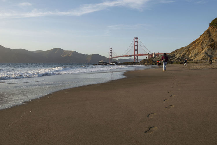 Golden Gate Bridge from Baker Beach, San Francisco, California America Architecture Attraction Background Baker Bay Beach Beautiful Blue Bridge Cable California City Coast Crashing Day Evening Famous Francisco Gate Golden Historic Landmark Landscape Light Nature No People Ocean Pacific Red Rock San Sand Sea Sky Skyline States Stayed Summer Sunset Suspension Tourism Tourist Tower Travel United USA Water Wave West