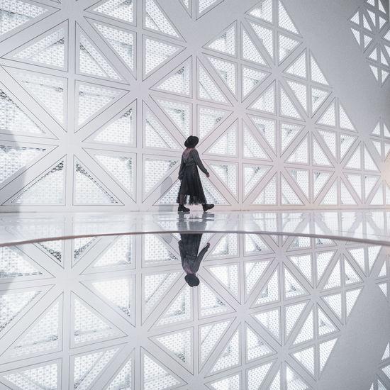 Full length of man standing on ceiling
