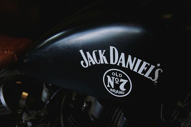 depth of field Interesting Oil Can Engineering Bike Engine Bike Motor Bike Motorcycle Jack Daniels Branding Stickers Brand Name Alcohol Vintage Bikers Old School Text Communication Indoors  Night No People Close-up