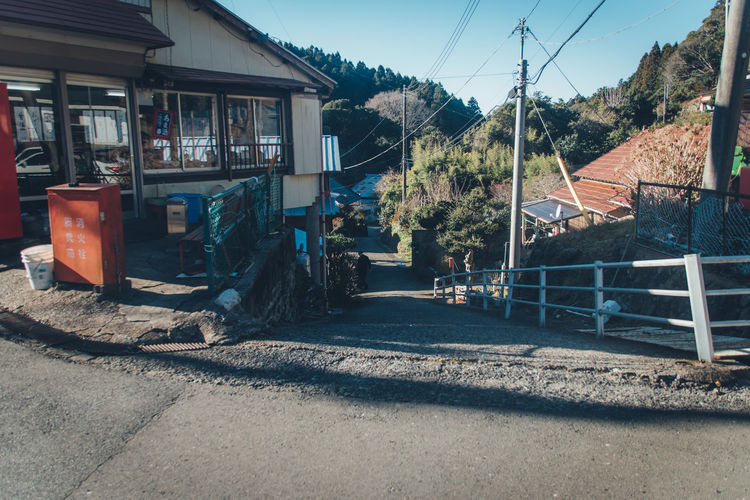 Japan Travel Calm Japan Travel Countryside Retro Styled Japan Culture Daytime Man Street Japanese Style Slope Nostalgia Nostalgic  Architecture Transportation Built Structure Building Exterior Day Road City Nature Mode Of Transportation No People Land Vehicle Sunlight Building House Sky Power Line  Outdoors Electricity  Motor Vehicle Power Supply My Best Photo