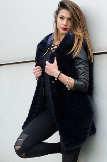fashion clothing autumn winter One Person Young Adult Women Wall - Building Feature Beautiful Woman Beauty Young Women Long Hair Three Quarter Length Hair Front View Clothing Adult Fashion Indoors  Hairstyle Real People Lifestyles Leather Warm Clothing