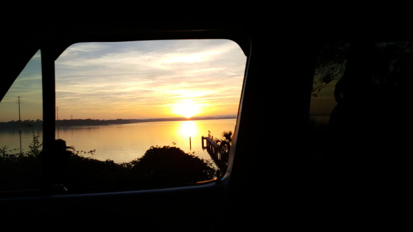 Catch a little of the Sunset on the way home tonight Scenic Drives Sunsets In Motion Evening Sky Fresh On Eyeem  Sunset Silhouette Reflection Cloud - Sky Water Sky Tranquility Beauty In Nature Nature